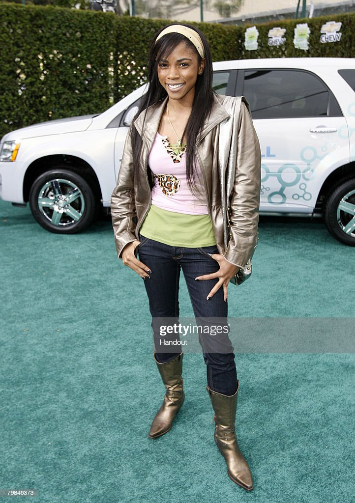 In this handout provided by General Motors, Actress Shanica Knowles stops on the green carpet near the Chevrolet Equinox Fuel Cell upon her arrival at Chevy Rocks the Future, an entertainment and education event designed to inspire Los Angeles-area school children to protect the environment at The Walt Disney Studios on February 19, 2008 in Burbank, California.