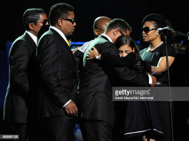 In this handout provided by Harrison Funk and Kevin Mazur, Jermaine Jackson, Tito Jackson, Marlon Jackson, Paris Jackson and Janet Jackson attend...