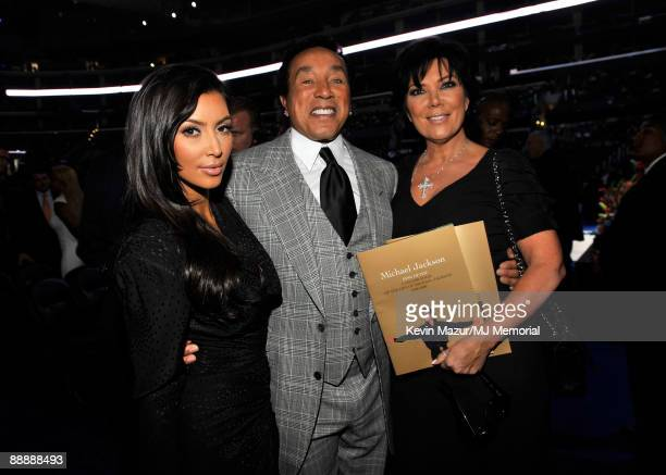 In this handout provided by Harrison Funk and Kevin Mazur TV personality Kim Kardashian singer Smokey Robinson and TV personality Kris Jenner attend...