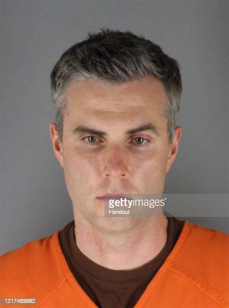 In this handout provided by Hennepin County Sheriff's Office former Minneapolis police officer Thomas Lane poses for a mugshot after being charged...