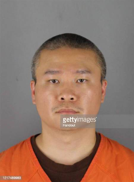 In this handout provided by Hennepin County Sheriff's Office former Minneapolis police officer Tou Thao poses for a mugshot after being charged with...