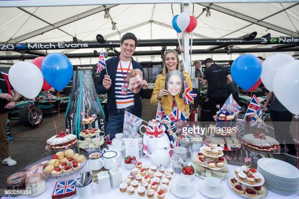 In this handout provided by Jaguar Panasonic Racing Formula E presenters Vernon Kaye and Nicki Shields celebrate the Royal Wedding while attending...