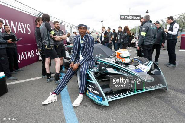 In this handout provided by Jaguar Racing Ballet dancer Eric Underwood on the grid with the Jaguar Racing team during the Paris ePrix Round 8 of the...