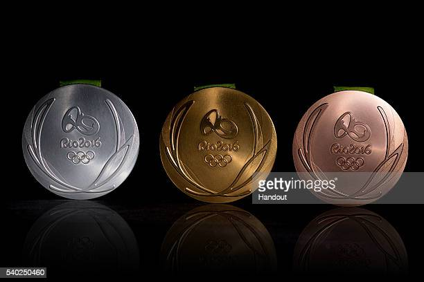 In this handout provided by Jogos Rio 2016 the front of the gold silver and bronze medals for the 2016 Summer Olympics are shown June 8 2016 in Rio...