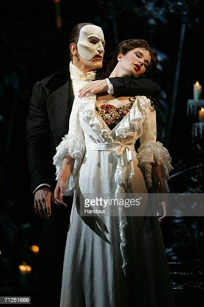 In this handout provided by Kirvin Doak Communications Anthony Crivello portrays 'The Phantom' and Sierra Boggess plays 'Christine' in a dress...