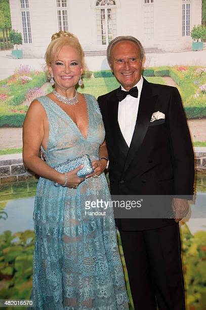 In this handout provided by Le Palais Princier, Marquess Roberta Gilardi and Dottore Donato Sestito pose during the Monaco Red Cross Gala on July 25,...