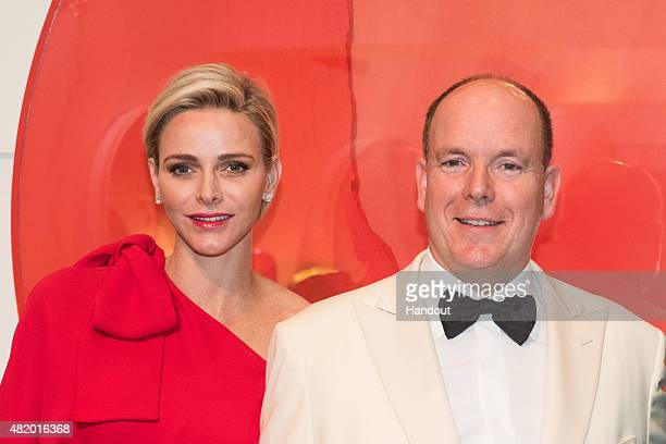 In this handout provided by Le Palais Princier, Princess Charlene of Monaco and Prince Albert II of Monaco pose during the Monaco Red Cross Gala on...