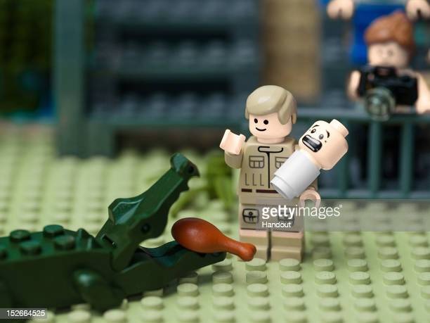 In this handout provided by LEGO Australia, a LEGO recreation of Steve Irwin feeding a crocodile with one hand, while cradling his baby son Bob in...
