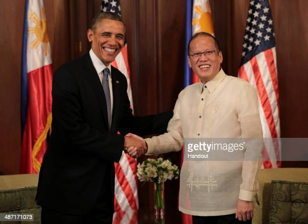 In this handout provided by Malacanang Photo Bureau' US president Barack Obama shakes hands with Philippine President Benigno Aquino at the...