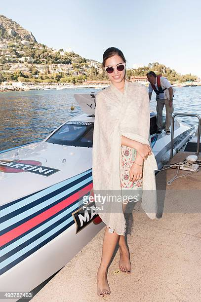 In this handout provided by Martini Fashion model Amber le Bon arrives on the Vector MARTINI Powerboat on qualifying day at the Monaco Grand Prix at...