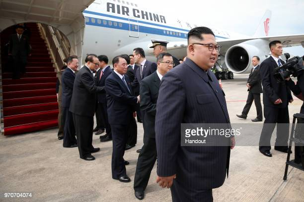 In this handout provided by Ministry of Communications and Information of Singapore North Korean leader Kim Jongun arrives at Changi Airport in...