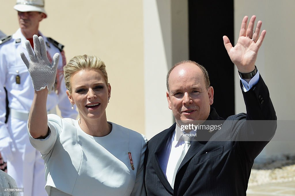 In This Handout Provided by Monaco Press Center, Prince Albert of Monaco and Princess Charlene of Monaco walk on the Palace Square after the Baptism of their twins Prince Jacques of Monaco and Princess Gabriella of Monaco at the Cathedral of Monaco on May 10, 2015 in Monaco, Monaco.