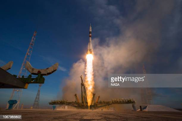 In this handout provided by NASA A Soyuz booster rocket launches the Soyuz MS11 spacecraft from the Baikonur Cosmodrome on December 3 2018 in...