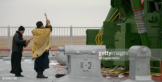 In this handout provided by NASA an Orthodox Priest blesses the Soyuz rocket at the Baikonur Cosmodrome Launch pad on November 16 2016 in Kazakhstan...
