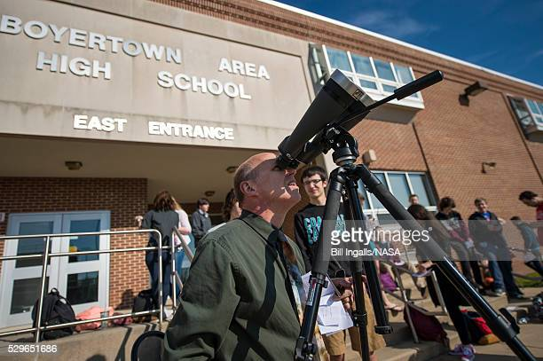 In this handout provided by NASA Boyertown Area High School astronomy teacher Peter Detterline prepares high powered binoculars with a solar filter...