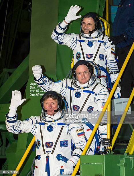 In this handout provided by NASA Expedition 43 Russian Cosmonaut Mikhail Kornienko of the Russian Federal Space Agency top NASA Astronaut Scott Kelly...