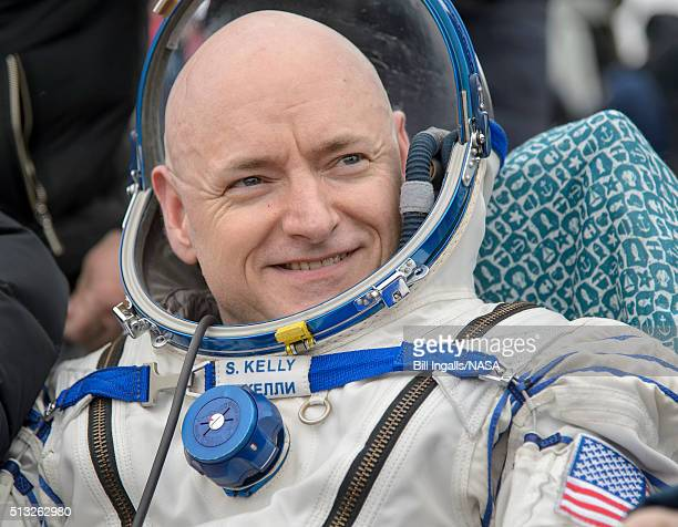 In this handout provided by NASA Expedition 46 Commander Scott Kelly of NASA rest in a chair outside of the Soyuz TMA18M spacecraft just minutes...
