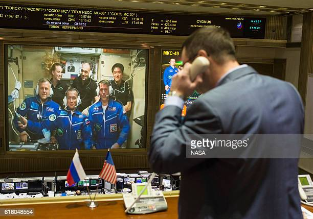 In this handout provided by NASA Expedition 49 Flight Engineers Andrey Borisenko of Roscosmos front left Sergey Ryzhikov of Roscosmos front center...