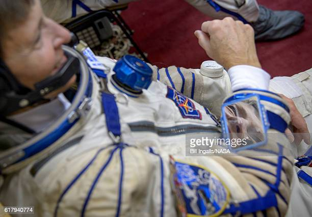 In this handout provided by NASA Expedition 50 NASA astronaut Peggy Whitson is seen after donning her Sokol suit ahead of her final qualification...