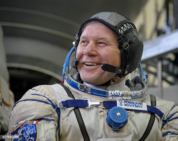 In this handout provided by NASA Expedition 50 Russian cosmonaut Oleg Novitskiy of Roscosmos smiles as he listens to a reporter's question ahead of...