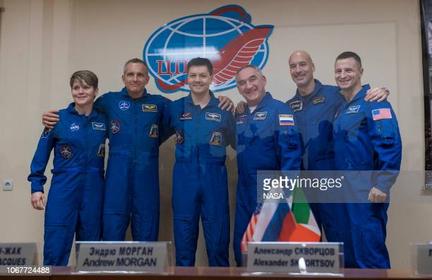 In this handout provided by NASA Expedition 58 prime crew members left to right Flight Engineer Anne McClain of NASA Flight Engineer David...