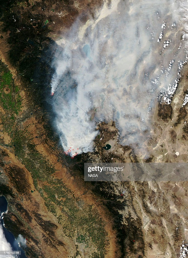 In this handout provided by NASA from the Moderate Resolution Imaging Spectroradiometer (MODIS) on NASAs Aqua satellite shows the drought-fueled Rim fire burning on August 23, 2013 near Yosemite National Park, California. The Rim Fire continues to burn out of control and threatens thousands of homes and structures outside of Yosemite National Park.