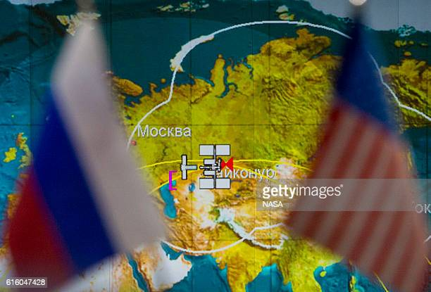 In this handout provided by NASA icons for the International Space Station and Soyuz MS02 spacecraft are seen on a tracking map on a screen at the...