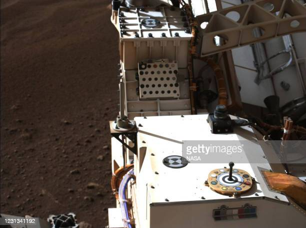 In this handout provided by NASA, Mastcam-Z, a pair of zoomable cameras aboard NASA's Perseverance rover, images its calibration target for the first...