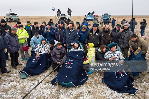 In this handout provided by NASA Russian cosmonauts Mikhail Kornienko left Sergey Volkov of Roscosmos center and Expedition 46 Commander Scott Kelly...