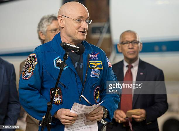 In this handout provided by NASA Scott Kelly of NASA speaks as he arrives after landing at Ellington Field after his return to Earth on March 3 2016...