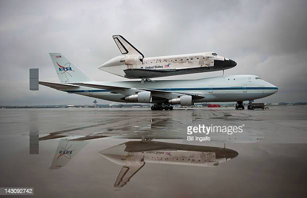 In this handout provided by NASA Space Shuttle Discovery mounted atop a NASA 747 Shuttle Carrier Aircraft is seen a few hours before being demated at...