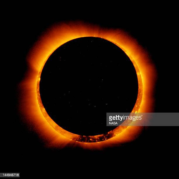 In this handout provided by NASA sun spots are seen as the moon moves into a full eclipse position after reaching annularity during the first annular...
