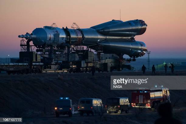 In this handout provided by NASA T The Soyuz booster rocket and MS11 spacecraft are rolled out to the launch pad by train at the Baikonur Cosmodrome...