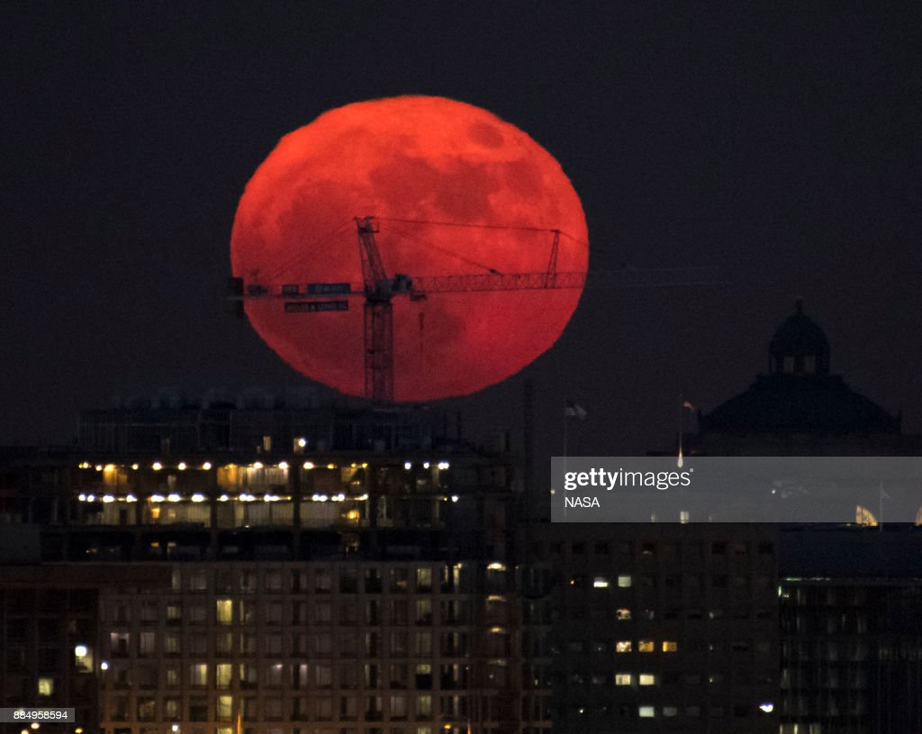 In this handout provided by NASA, the moon is seen as it rises on December 3, 2017 in Washington, DC. Today's full Moon is the first of three consecutive supermoons. The two will occur on Jan. 1 and Jan. 31, 2018. A supermoon occurs when the moon's orbit is closest (perigee) to Earth at the same time it is full.