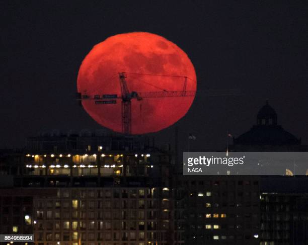 In this handout provided by NASA the moon is seen as it rises on December 3 2017 in Washington DC Today's full Moon is the first of three consecutive...