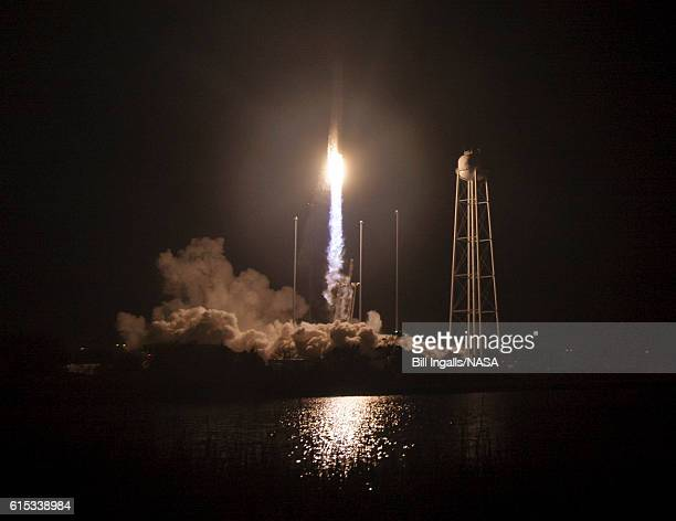 In this handout provided by NASA the Orbital ATK Antares rocket with the Cygnus spacecraft onboard launches from Pad0A at NASA's Wallops Flight...