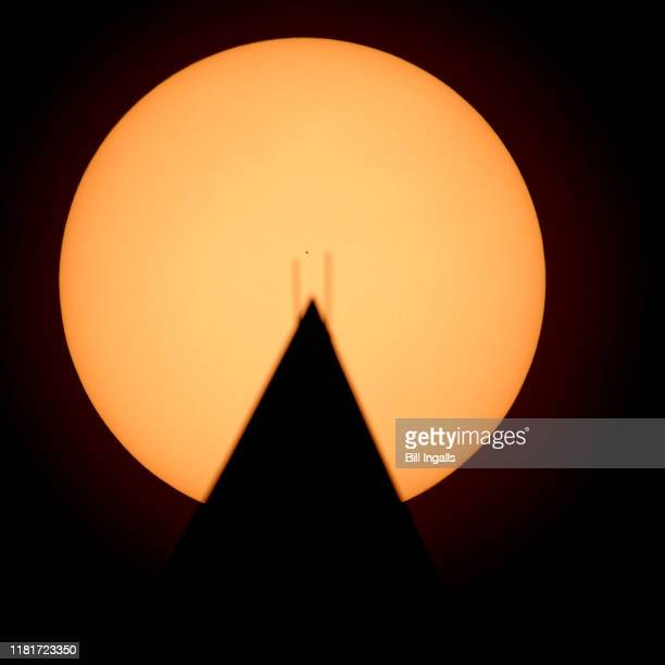 In this handout provided by NASA the planet Mercury is seen in silhouette center as it transits across the face of the Sun behind the Washington...