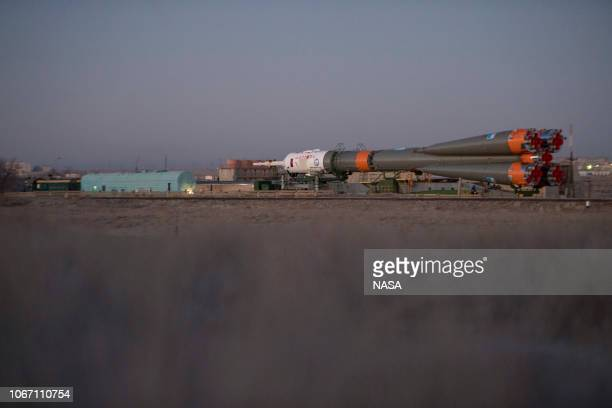 In this handout provided by NASA The Soyuz booster rocket and MS11 spacecraft is rolled out to the launch pad by train at the Baikonur Cosmodrome on...