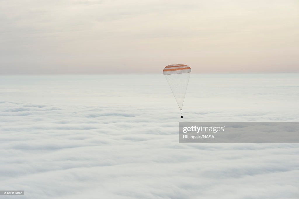 In this handout provided by NASA, The Soyuz TMA-18M spacecraft is seen as it lands with Expedition 46 Commander Scott Kelly of NASA and Russian cosmonauts Mikhail Kornienko and Sergey Volkov of Roscosmos on March 2, 2016 near the town of Zhezkazgan, Kazakhstan. Kelly and Kornienko completed an International Space Station record year-long mission to collect valuable data on the effect of long duration weightlessness on the human body that will be used to formulate a human mission to Mars. Volkov returned after spending six months on the station.
