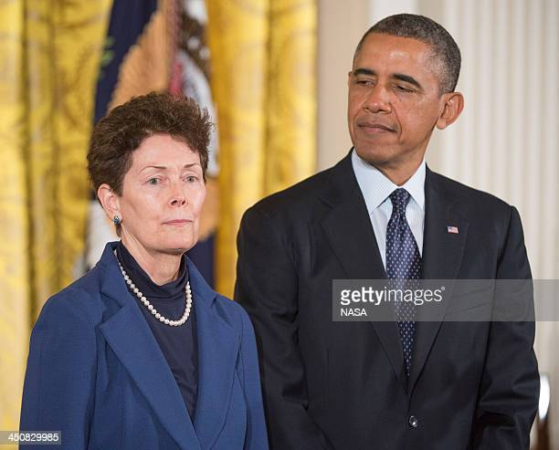 In this handout provided by NASA US President Barack Obama presents the Presidential Medal of Freedom to Tam O'Shaughnessy Sally Ride's life partner...