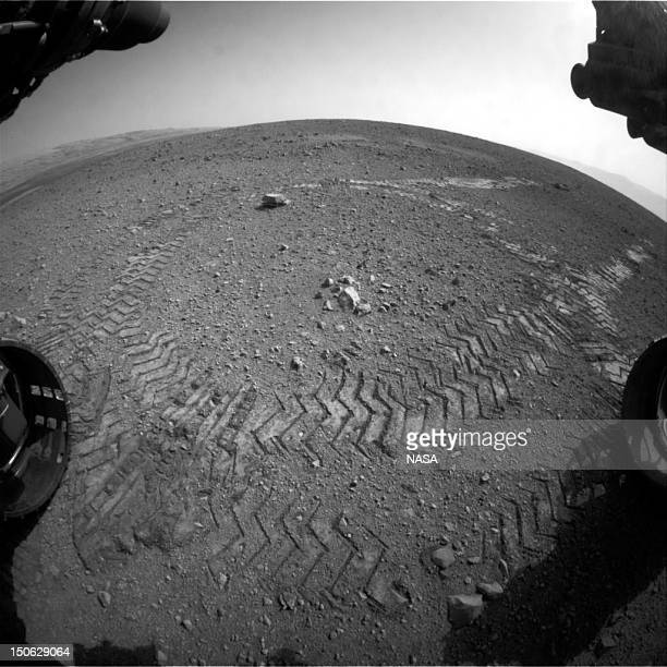 In this handout provided by NASA/JPLCaltech tracks from NASA's Curiosity Mars rover are seen August 22 2012 on Mars According to NASA the rover moved...