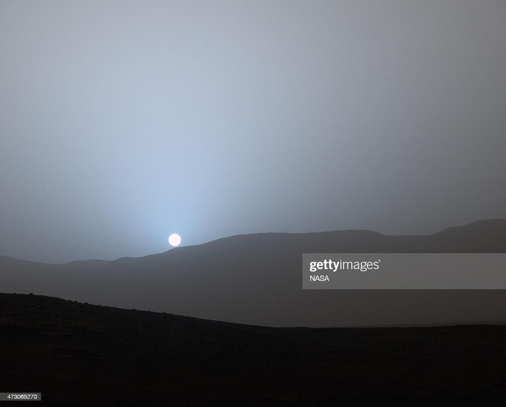In this handout provided by NASA/JPL-Caltech/MSSS, NASA's Curiosity Mars rover recorded this view of the sun setting at the close of the mission's 956th Martian day, or sol April 15, 2015, from the rover's location in Gale Crater, Mars.