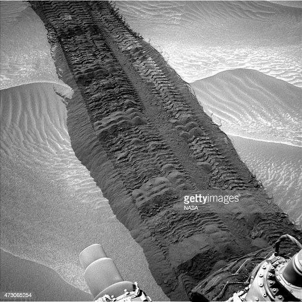 In this handout provided by NASA/JPLCaltech/MSSS This image from the Navigation Camera on NASA's Curiosity Mars rover shows wheel tracks printed by...