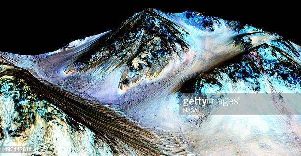 In this handout provided by NASA's Mars Reconnaissance Orbiter dark narrow streaks on the slopes of Hale Crater are inferred to be formed by seasonal...