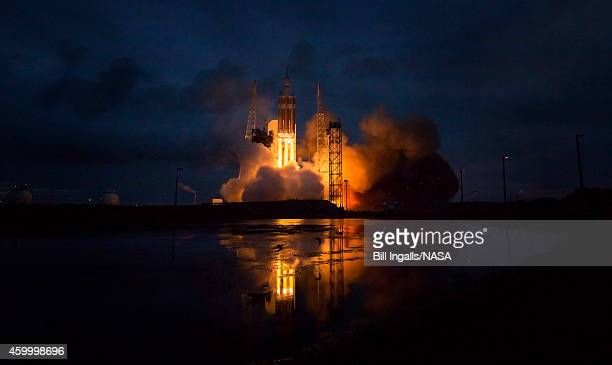 In this handout provided by NASAThe United Launch Alliance Delta IV Heavy rocket with NASA's Orion spacecraft mounted atop lifts off from Cape...