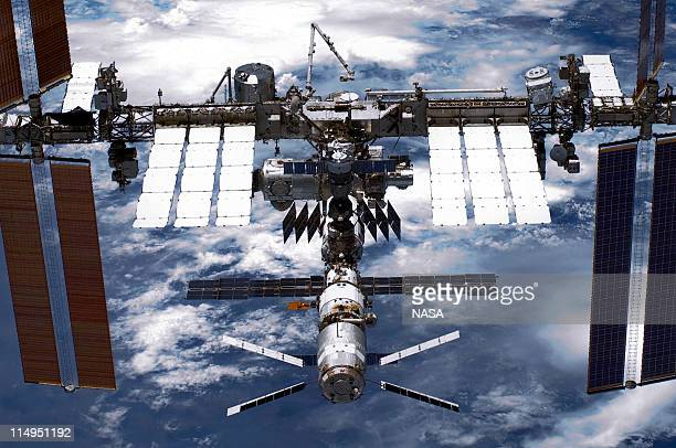 In this handout provided by National Aeronautics and Space Administration , back dropped by planet Earth the International Space Station is seen from...