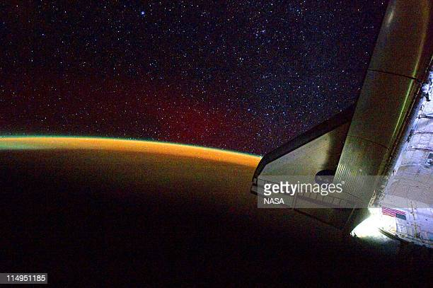 In this handout provided by National Aeronautics and Space Administration Earth's thin line of atmosphere and a starry sky are seen just off the port...