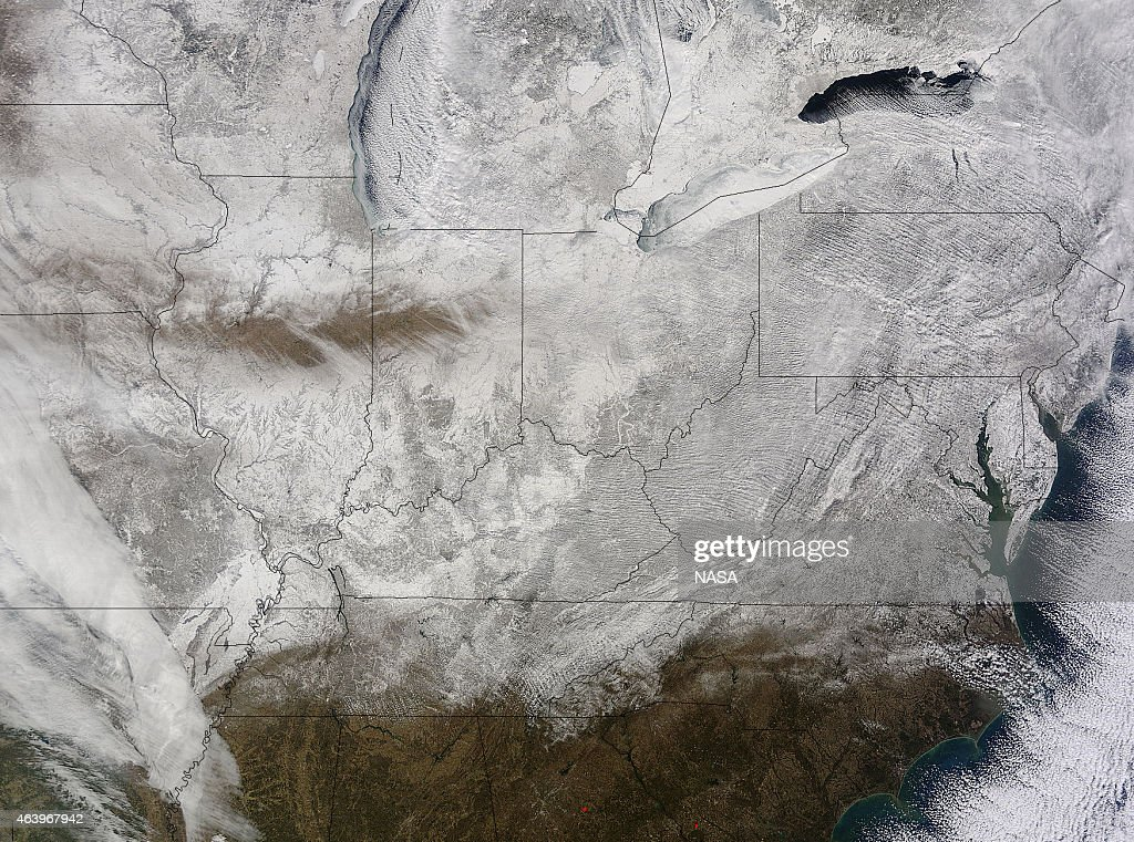 In this handout provided by National Aeronautics and Space Administration (NASA), snow covers the eastern United States on February 19, 2015 as seen from NASA's Terra satellite. More record low temperatures are expected to continue through Saturday.