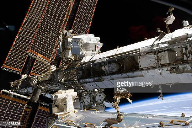 In this handout provided by National Aeronautics and Space Administration , the newly-installed Alpha Magnetic Spectrometer-2 is visible at center of...