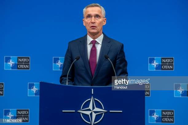 In this handout provided by NATO, Jens Stoltenberg, Secretary General of NATO speaks at a press conference ahead of the NATO Leaders meeting at the...